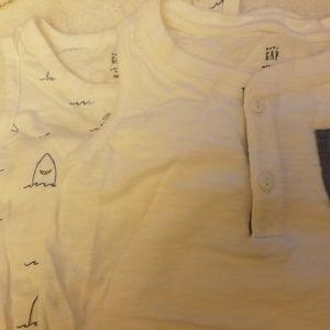 2 white tank onsie shirts